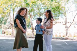 St Ambrose Catholic Primary School Concord West teacher speaking with parent and student